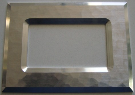 Frame with hammer blow finish