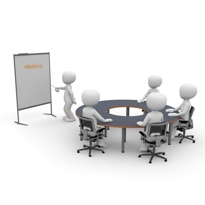 Dummys around table in meeting