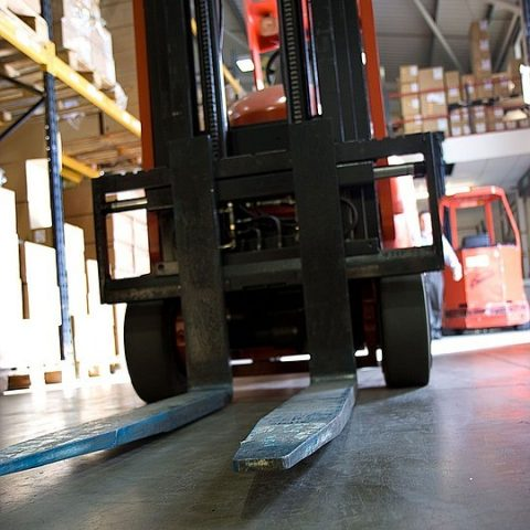 Forklift parked in stock area