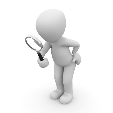 Figure with magnifying glass